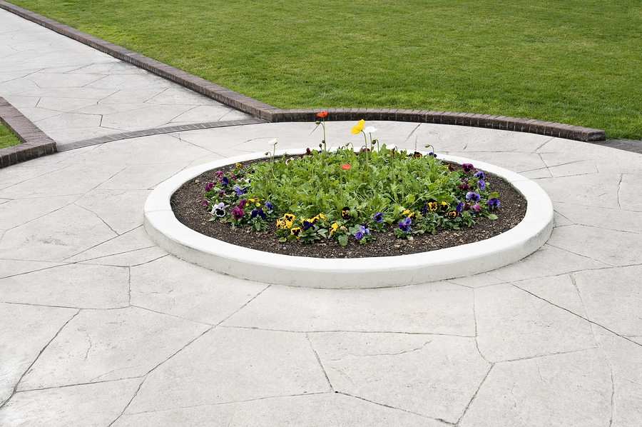 landscaping showing walkway flower bed and green lawn
